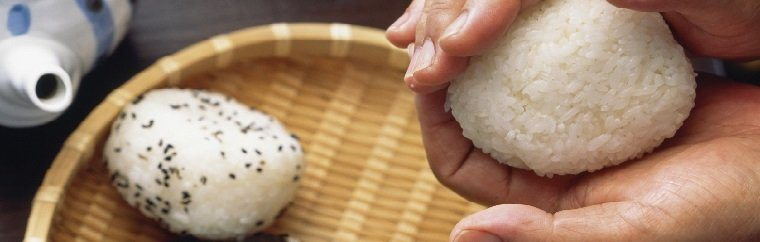 "Sometimes also known as ""omusubi,"" onigiri are triangular rounded balls of rice. Most are wrapped in nori (seaweed) so that they are easier to hold. They are often used as a portable food that you don't need chopsticks or tableware to eat."