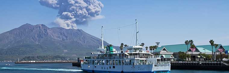 Sakurajima is an active composite volcano located in Kagoshima Bay. It is a symbol of Kagoshima, and part of Kirishima-Yaku National Park. The volcano began to form around 26,000 years ago, and it has had 17 major eruptions. Sakurajima used to be an island, as its name suggests (shima means island), but the lava flow from the 1914 eruption filled the strait between Sakurajima and the mainland, connecting it to the Osumi Peninsula. Even in the present day, Sakurajima has small-scale eruptions nearly daily. However, many people live on Sakurajima. It is said that volcanoes are a source of blessings, including delicious crops and hot springs that relieve people's fatigue. The smoke that Sakurajima spews is powerful and entrancing, making it a popular attraction.