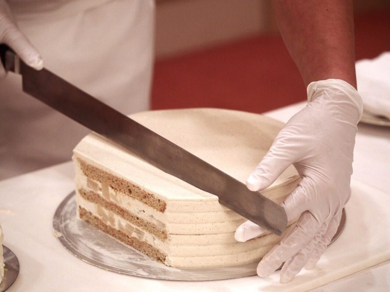 Chef Cutting a Cake