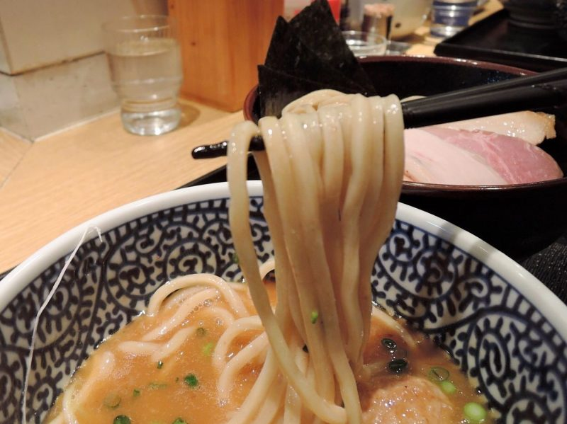The balance between the rich soup and thick noodles