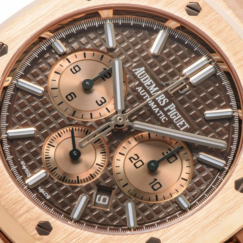 "The brown dial features the ""Grand Tapestry"" pattern"