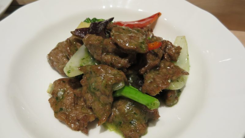Beef sautéed with mixed vegetables and basil