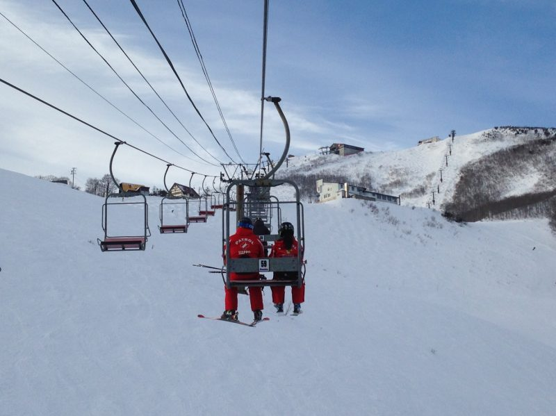 Travel by ski lift while looking out over the beautiful scenery.