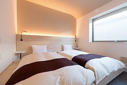 Relax in the rooms, filled with soft indirect lights and beautiful wood-grained finishes